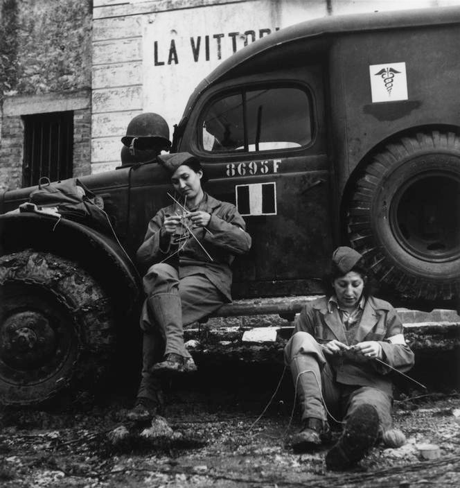 holdentumblr:  Robert Capa (1913-1954)Drivers from the French ambulance corps near the front, waiting to be called (Italy, 1944)Original album – Italy. Cassino Campaign. W.W.II.© 2001 By Cornell Capa, Agentur Magnum