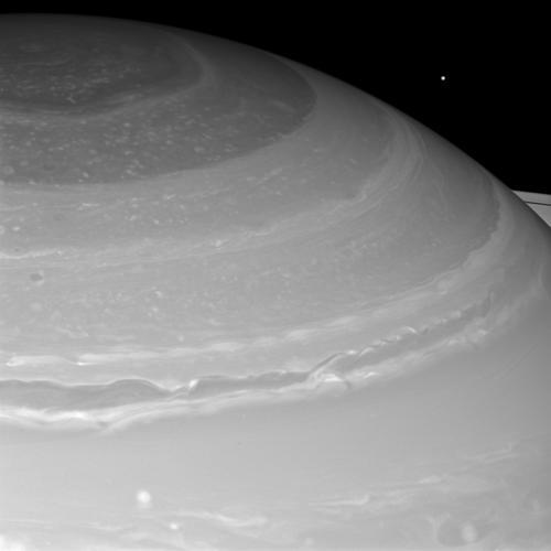 Mimas Peeks Over SaturnSaturn and its north polar hexagon dwarf Mimas as the moon peeks over the planet's limb. Saturn's A ring also makes an appearance on the far right. Mimas is 246 miles (396 kilometers) across. This view looks toward the sunlit side of the rings from about 21 degrees above the ringplane. The image was taken with the Cassini spacecraft wide-angle camera on Nov. 28, 2012 using a spectral filter sensitive to wavelengths of near-infrared light centered at 752 nanometers.