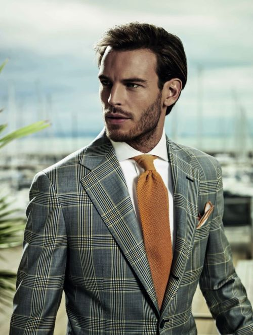 The pocket square is to close to the tie.  When in doubt, white linen or cotton always does the trick.