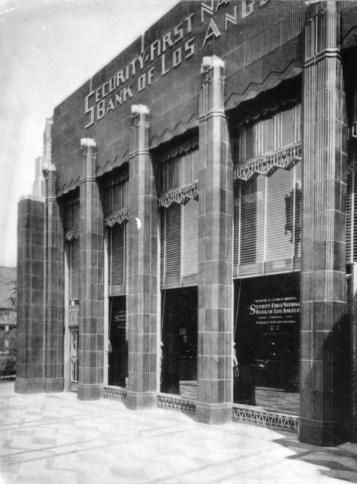 "postmodernism:    memoriastoica:    Security-First National Bank of Los Angeles, located at 5209 Wilshire Boulevard. Building is an art deco black and gold, single-story, terra-cotta sheathed building. Architects: Morgan, Walls & Clements. Date built: 1929.    Now it's just called ""The Deco Building"" and it's mainly used as an office space and for film/TV shoots. It has this funky front desk made out of a Douglas DC-8 jet turbine cowling:     Also notice that the E. Clem Wilson building, that now abuts the western side of this building, hasn't been built yet. It would be completed about a year after this photograph was taken, during the summer of 1930."