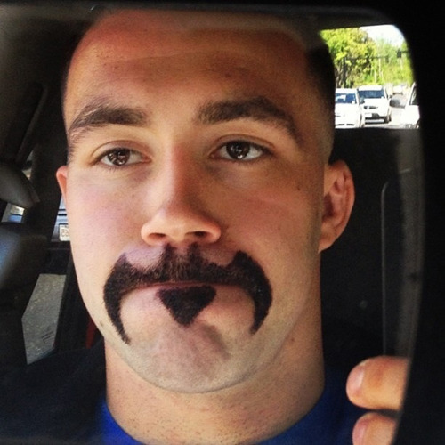 "alexandraerin:  iheartchaos:  Facial hair of the day: The Batstache Via  Oliver Queen looked at this picture and said, ""I have a brilliant new idea to protect my secret identity."""
