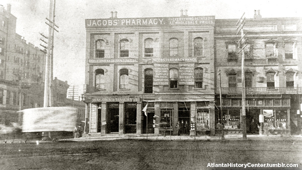 "Here's a rare photo of Jacobs' Pharmacy, where the first Coca-Cola fountain drink was sold on May 8, 1886. According to The Coca-Cola Company website, Dr. John Pemberton, an Atlanta pharmacist, ""carried a jug of the new product down the street to Jacobs' Pharmacy, where it was sampled, pronounced ""excellent"" and placed on sale for five cents a glass."" Jacobs' Pharmacy was located on the southwest corner of Peachtree and Marietta Streets in Atlanta. The Atlanta History Center's Kenan Research Center houses the Joseph and Sinclair Jacobs Papers. The majority of this collection documents the professional activities of Dr. Joseph Jacobs, and his son Sinclair Jacobs as proprietors of Jacobs' Pharmacy in Atlanta. Among the official records of Jacobs' Pharmacy are samples of labels for products, a notebook and loose papers containing formulae for medicines and cosmetics, product catalogs, copies of Jacob's Monthly Magazine, and official correspondence. The collection also contains personal items of Joseph and Sinclair Jacobs, including professional journals such as Drug Topics, and the American Journal of Pharmacy. Also included are newspaper clippings, and speeches and writings authored by Joseph Jacobs on the subjects of Crawford Long, The Coca-Cola Company, and medical drugs used during the Civil War. Browse our collection."