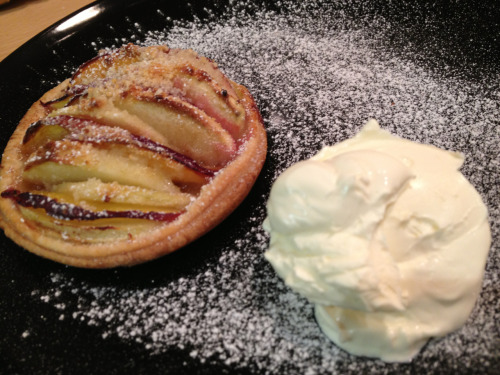 Recipe - Apple & Nectarine Tart I made these a couple of days ago when my cousin came to visit & she declared them to have replaced cheesecake as her favourite dessert. As they were such an instant hit I decided it would be rude of me not to share their deliciousness with you! This will make four tarts so alter the recipe as you need to make the number you require. Half a pack shop bought shortcrust pastry Flour for dusting 1 eating apple (I used a granny smith as they are my favourite) 1 ready to eat nectarine 8 tsp ground almonds 8 tsp sugar (golden caster or light brown sugar works best) 4 tsp ground cinnamon 2 tsp icing sugar  Preheat the oven to 220 degrees. Take a small baking tray or large yorkshire pudding tin & dust it lightly with flour. Dust a large chopping board & your rolling pin with flour. Roll out the pastry until it is around half a centimetre thick.  Cut out four circles the same size using a large scone/cookie cutter & carefully transfer onto the tray. If you don't have a cutter then gently place a cup/glass/other circular item onto the pastry & cut round it with a knife. Sprinkle two tsp of ground almonds in each pastry tart base followed by one tsp of cinnamon & one tsp of sugar (the rest of the sugar reserved for later). Cut the nectarine into very thin slices being careful of the stone. Peel, core & slice the apple into similarly thin pieces. BTW if you don't finish assembling the tarts & bake straight away the apple will start to turn brown as it oxidises. Alternating between apple & nectarine fill the tarts with fruit. Sprinkle with remaining sugar (1 tsp per tart) & bake for 25-30 minutes or until the pastry is golden & the edges of the fruit slices are starting to caramelise & brown. Using a spatula carefully lift tarts onto serving plates, dust with icing sugar (I use a tea strainer as a mini sieve to dust half a teaspoon over each tart) & serve whilst hot. We enjoyed our tarts with cream but they would be lovely with ice cream if you prefer.