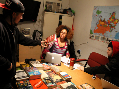 "hiphopeducation:  BRONX HIP-HOP COLLECTIVE TO LAUNCH A 'RADICAL' LIBRARY FOR YOUTH MOTT HAVEN — Rappers feed off great beats, but they're nourished by great books. That's one message the hip-hop-centric Rebel Diaz Arts Collective hopes to convey to local youth with a community library they will soon run out of their headquarters in a former candy factory by the Bruckner Expressway. ""I tell them, 'The more you read, the iller you'll be as an emcee,'"" said Rodrigo Venegas, aka Rodstarz, one-third of the rap crew, Rebel Diaz, and a founding member of the cultural collective with an activist bent. The roughly 20-member collective has partnered with Bluestockings, the independent Lower East Side bookstore, to amass about 300 mostly donated books on radical politics, Hispanic and black history and hip hop. By erecting the small library in the same space where it hosts monthly hip-hop open mic nights that draw rising rappers and their fans from across the city, the collective is trying to convince these young people that the slickest rhymers are often also the sharpest readers. ""If we make it cool to read books in the South Bronx,"" Venegas said, ""then it's a victory."" The Richie Perez Radical Library, named for a South Bronx educator and activist who died in 2004, combines works by influential thinker-agitators, such as Angela Davis and Malcolm X, with writings by hip-hop luminaries including KRS-One, the RZA and Jay-Z. Read more: http://www.dnainfo.com/new-york/20130205/mott-haven/bronx-hip-hop-collective-launch-radical-library-for-youth#ixzz2KG03anOL  #radical library #youth #radical #hiphop collective #thinkers #agitators # Lower East Side bookstore"