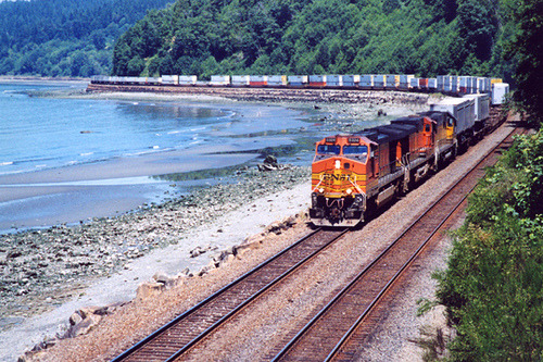 railxing:  seattle-wa:  Freight Train, Carkeek Park, Seattle by acanyc on Flickr.  BNSF train near Seattle. Looks like the scenic sub.