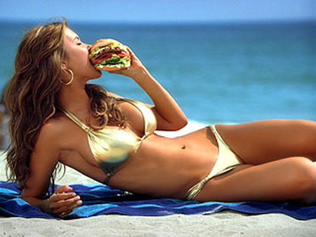 Audrina Patridge eats a burger for Carl's Jr