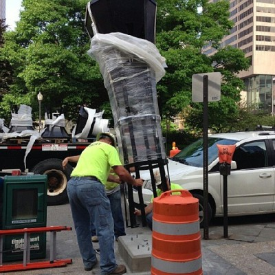 From Dispatch Web producer @cnelson624: A 10-foot-tall planter is lowered into place on S. 3rd St. as part of a $1M project around Capitol Square.  (at Au Bon Pain)