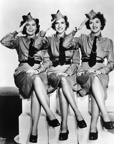 thevintagethimble:  The Andrew SistersThe Andrews Sisters pose for a studio group portrait, saluting and wearing military uniforms, in 1941 in the United States. (Photo by Gilles Petard/Redferns)