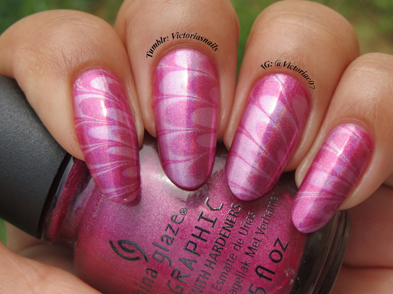 I absolutely had to water marble with my new China Glaze Hologlam polishes! This is outdoors, kinda cloudy so not much holo effect, but pretty nonetheless.