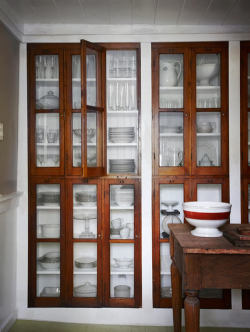 True Identity Concepts:  Adding glass to built-in cabinets is worth the additional expense when the end result is an architectural feature that makes displaying everyday items that look like art. Photo Source: Life on Sundays