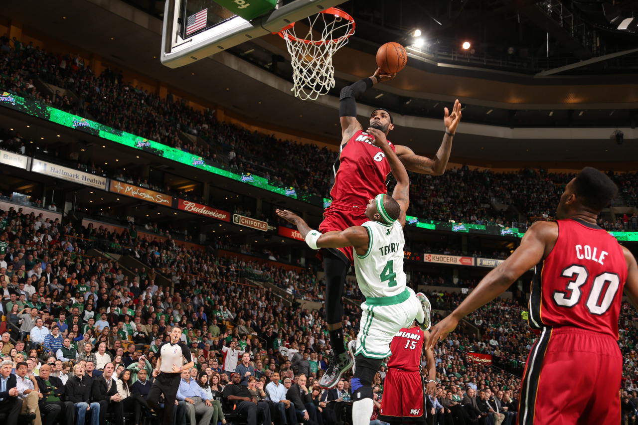nba:  LeBron James of the Miami Heat dunks on an alley-oop pass against Jason Terry of the Boston Celtics on March 18, 2013 at TD Garden in Boston, Massachusetts. (Photo by Nathaniel S. Butler/NBAE via Getty Images)