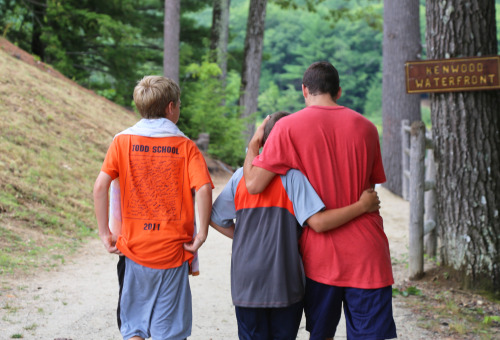 a counselor having a wonderful moment with campers at our co-ed summer camp