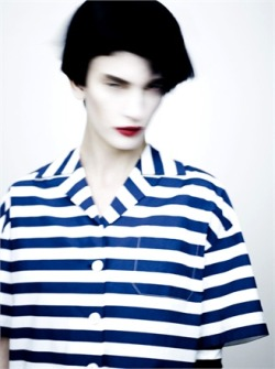 Stripes Women trapped inside colorful stripes inspired by the nautical world. A revamped classic pattern for next season. Photo by Paolo Roversi, 2011