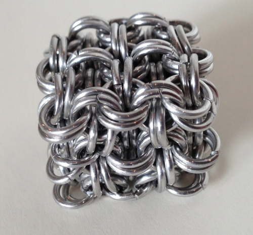 I made a chainmail cube. =D isn't it adorable?