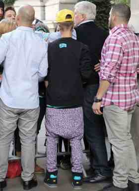 Justin Bieber wearing what looks like a pair of Nicki Minaj's pants that was custom made for her big ass. Look at all that butt space.