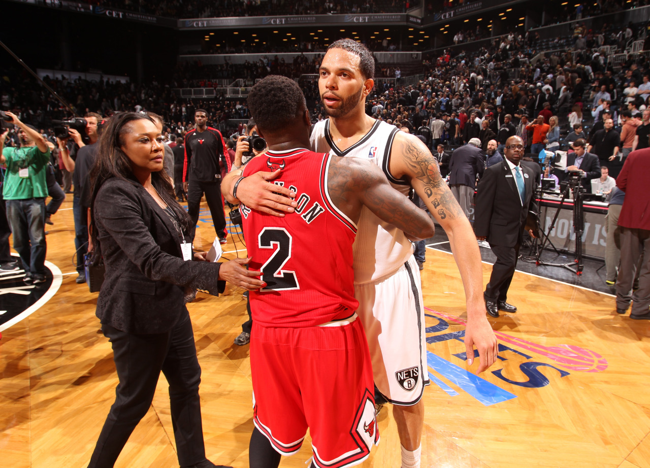 nba:  Nate Robinson of the Chicago Bulls and Deron Williams of the Brooklyn Nets greet each other after Game Seven of the Eastern Conference Quarterfinals during the 2013 NBA Playoffs at the Barclays Center on May 4, 2013 in the Brooklyn borough of New York City.  (Photo by Nathaniel S. Butler/NBAE via Getty Images)