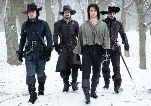 Exclusive first look at The Musketeers, brand new drama coming to BBC One in 2014. Picture shows D'Artagnan (Luke Pasqualino), Athos (Tom Burke), Aramis (Santiago Cabrera) and Porthos (Howard Charles)