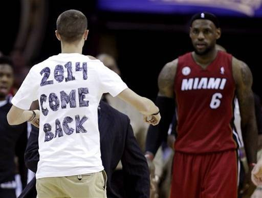 Look at this bizarre Cleveland Cavailiers/LeBron James/Miami Heat fan.  AP Photo/Tony Dejak