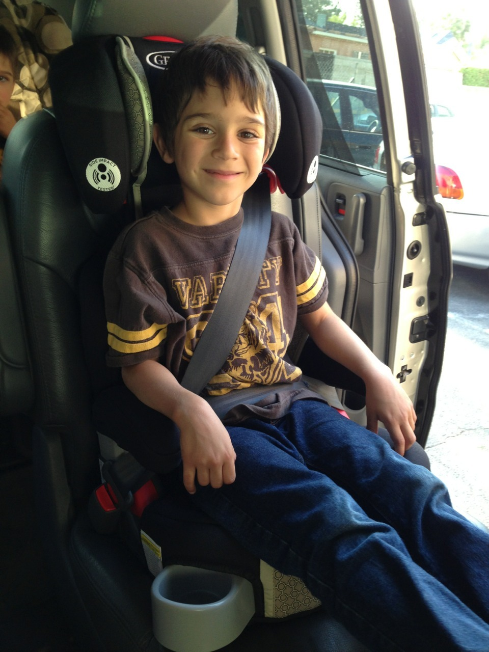 When your six you can move into a booster seat!  Sweet!