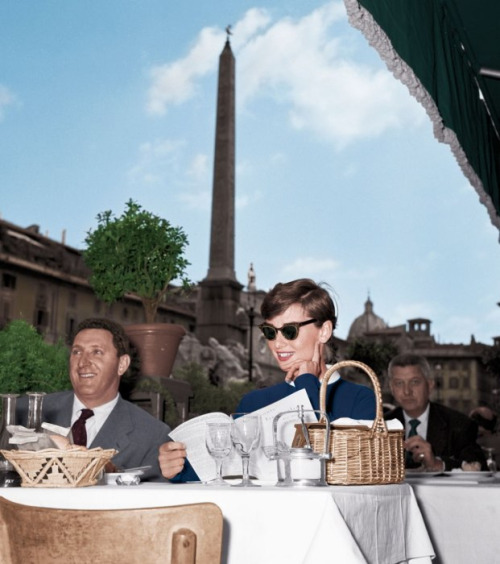 victorielle:   Audrey Hepburn at a café in the Piazza Navona with her signature basket purse, 1955.