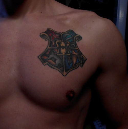 fuckyeahtattoos:  First tattoo, Hogwarts (Harry Potter) Crest on my chest. Done by Chris Sosa at Mean Street Tattoo in Syracuse, NY