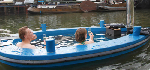 springwise:  Wood-fired hot tub doubles as a boat for touring on the open water If movie buffs can watch their favorite films while soaking in a relaxing hot tub, then why shouldn't boating enthusiasts be afforded a similar luxury? That's where HotTug comes in, with a wood-fired hot tub that doubles as a boat for cruising on the open water. READ MORE…  Epically repulsive but somehow compelling at the same time