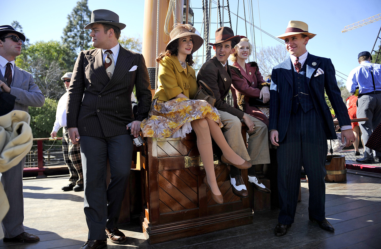 "latimes:  Dapper Day at Disneyland Whether it's because of the excuse to dress up, to rebel against the everyday jeans and t-shirt ensemble or something more, thousands of people line up to attend Disneyland in elaborate fashion on Dapper Day. So what is it like to walk around Disneyland during Dapper Day? Follow along with Times writer Rick Rojas:  Young men with knee-length basketball shorts hanging off their hips shuffled alongside dads in cargo shorts and socks pulled up to their shins. Moms, their hair pulled back in no-nonsense ponytails, trudged along in capri pants pushing strollers loaded down like the truck in ""The Grapes of Wrath.""  Check out the full account of the pseudo-holiday here. Photos: Christina House / For The Times"