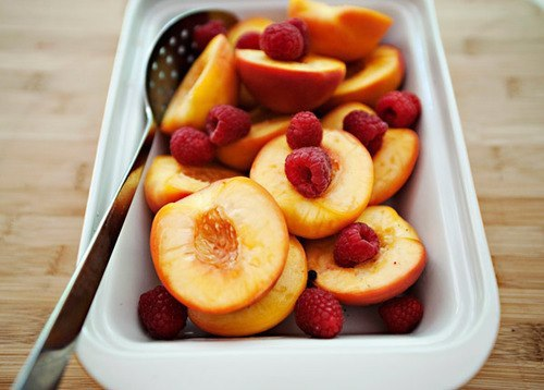 Poached Peaches with Raspberries 2 cups water1 1/4 cups sugar (I used vanilla sugar so you will see vanilla beans in the pictures, but regular sugar is just fine)3/4 cup dry white wine1/4 teaspoon salt1 cinnamon stick snapped in halfthe zest of one lemon (I used a vegetable peeler and got big strips)1/4 teaspoon peppercorns6 peaches6 ounces raspberries Put all of the ingredients except the peaches and raspberries into a large pot. Halve the peaches and remove the pit. Add the peaches and bring the pot to a boil. Cover the pot with parchment paper and reduce the heat to a simmer. Cook the peaches in the poaching liquid for 7-10 minutes (this depends on the peaches. I checked mine every few minutes and pulled them when I could get a knife through them with no resistance, but they were not completely mushy.) Take the peaches out of the cooking liquid. Add half of the raspberries to the cooked peaches. Add the remaining raspberries to the pot and bring it back to a boil. Reduce the cooking liquid to about half. Strain the poaching liquid. Pour the glorious poaching liquid over the peaches and raspberries. These are perfect just like this. But they would be pretty tasty in your morning cereal, oatmeal or on top of a waffle or pancake. Vanilla ice cream? Yes please.