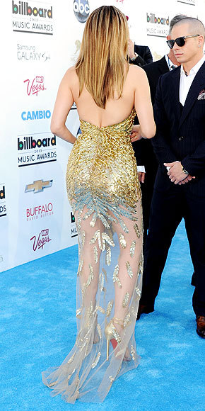 Better From The Back? Jennifer Lopez at the Billboard Music Awards If you think the back of J.Lo's shimmering gold gown is risqué, take a peek at the jaw-dropping plunging neckline.