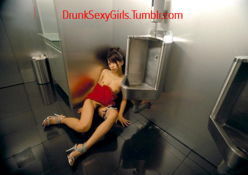 Drunk Japanese girl wonders how she got in the Men's Room…..