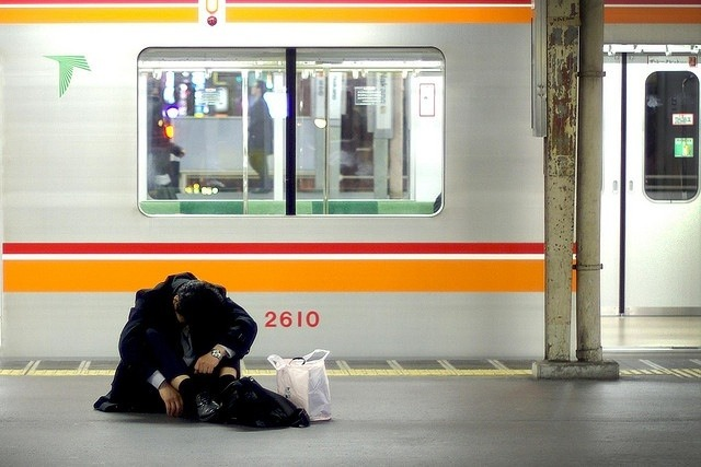 "JAPAN'S SUICIDAL SALARYMEN ARE DYING FOR WORK  I recently took a trip to Brussels and met a Japanese woman on vacation in the hostel I was staying in. At 4 AM that morning, when I heard Sayaka—my new Japanese friend—quietly answer her phone and creep from her bed to the downstairs computer room, I was naturally interested in what she was up to. A mole, keeping tabs on guests for the hostel owners? A weirdo, relaying late-night messages about Brussels to her parents because she didn't feel comfortable using the internet in daylight? No, turns out it was the only holiday she had taken that year and the early morning computer visit was to finish off some ""urgent"" work for her boss, which is a pretty sucky way to spend your vacation. Then again, it's still better than the 16-hour days at the office that awaited her at home.      Sayaka's situation isn't uncommon. A large amount of the population in Japan's biggest cities have a destructive relationship with work, literally, with many grinding themselves away to an early grave. The social phenomenon has its own word, karoshi, and it isn't death from digit-crippling labor in a sweatshop or accidents on a building site. It's suits in corporate buildings dying from strokes, heart attacks, or committing suicide after being worked to their limit.      Earlier this year, the suicide of 26-year-old Mina Mori was accepted as karoshi after an investigation found she'd been clocking up 140 hours of overtime every month, working at a popular chain restaurant called Watami. Employees for numerous companies are expected to embrace a work culture that's destroying their lives—a kind of worse version of the embrace through gritted-teeth I'd imagine David Miliband gave his brother when he got the party leader job—but a firm, necessary embrace nonetheless.   Karoshi was first recognized in the late 60s, when a guy in the shipping department of Japan's largest newspaper company died after having a stroke, which seemed kind of unusual for a 29-year-old, until people realized that radically overworking a human can have negative effects on the body, which somehow managed to be a surprise. Since then, cases have become relentless battles between family members of the deceased trying to prove their relatives died from being overworked, and the company in question trying their hardest to sweep it under the ever-lumpier rug.    Continue"