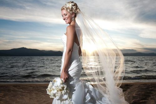 NEW Hairstyle Photo Gallery! - Beach Wedding Hairstyles From destination weddings to all the gorgeous local coasts, beach weddings are popular for a reason. The scenic backdrop is a romantic and beautiful location for your vows and party! When finding your beach wedding hairstyle, you can use those ocean breezes to your advantage an wear hair down or let a long veil flutter beautifully. If you want to keep every hair in place, opt for a half up bridal hairstyle, wedding braid, or classic curly updo.  Visit our website to see all 15 photos!