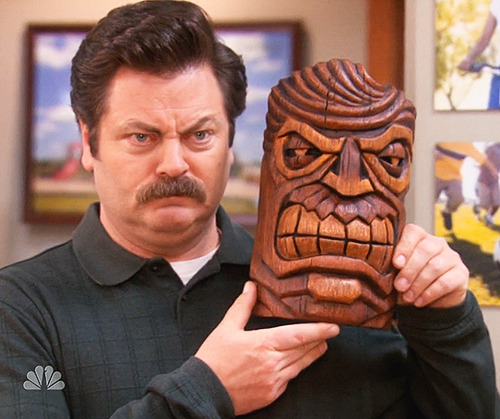 "thetvscreen:  ""Ron, this is the Hawaiian god of anger. It reminded us of you when you're at work."" ""A handsome gentleman."""