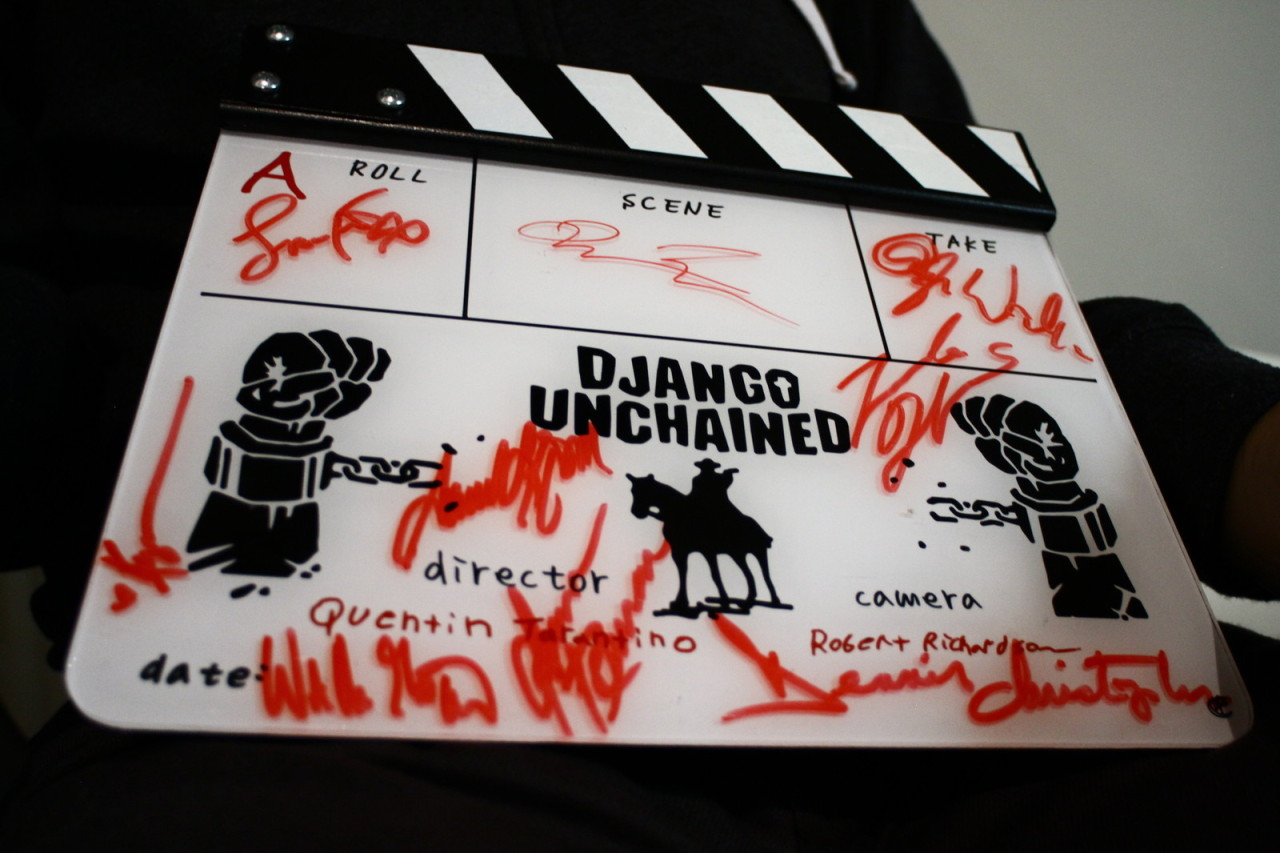A Django Unchained film slate was recently given to Gudmundur Felix Gretarsson. The slate is signed by Quentin Tarantino himself as well as all the stars of the film: Jamie Foxx, Christoph Waltz, Leonardo DiCaprio, Samuel L. Jackson, Dennis Christopher, James Remar, Walton Goggins and the beautiful Kerry Washington. All of them agreed to sign the slate for auction to help raise funds for Gudmundur Felix to realize his dream. More info about Gudmundur and the fundraising. Django Unchained script for your consideration.