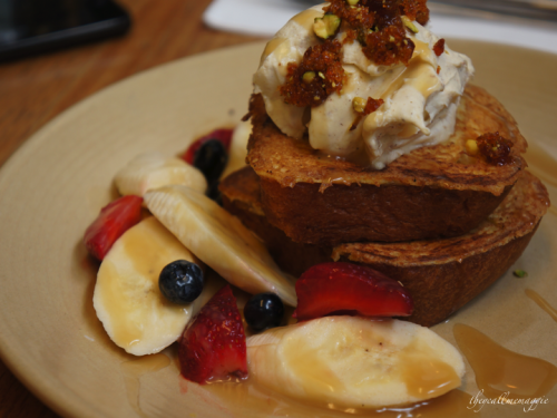 Brioche french toast - with fresh berries, banana, spiced mascarpone, pistachio praline & butterscotch sauce.