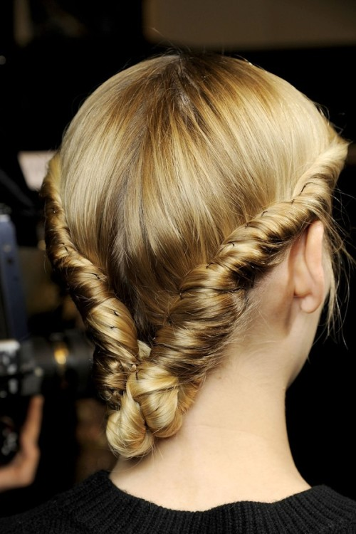 Cool braid! Twist your hair back on either side of your head (without creating a parting) and secure into a bun at the nape of your neck.