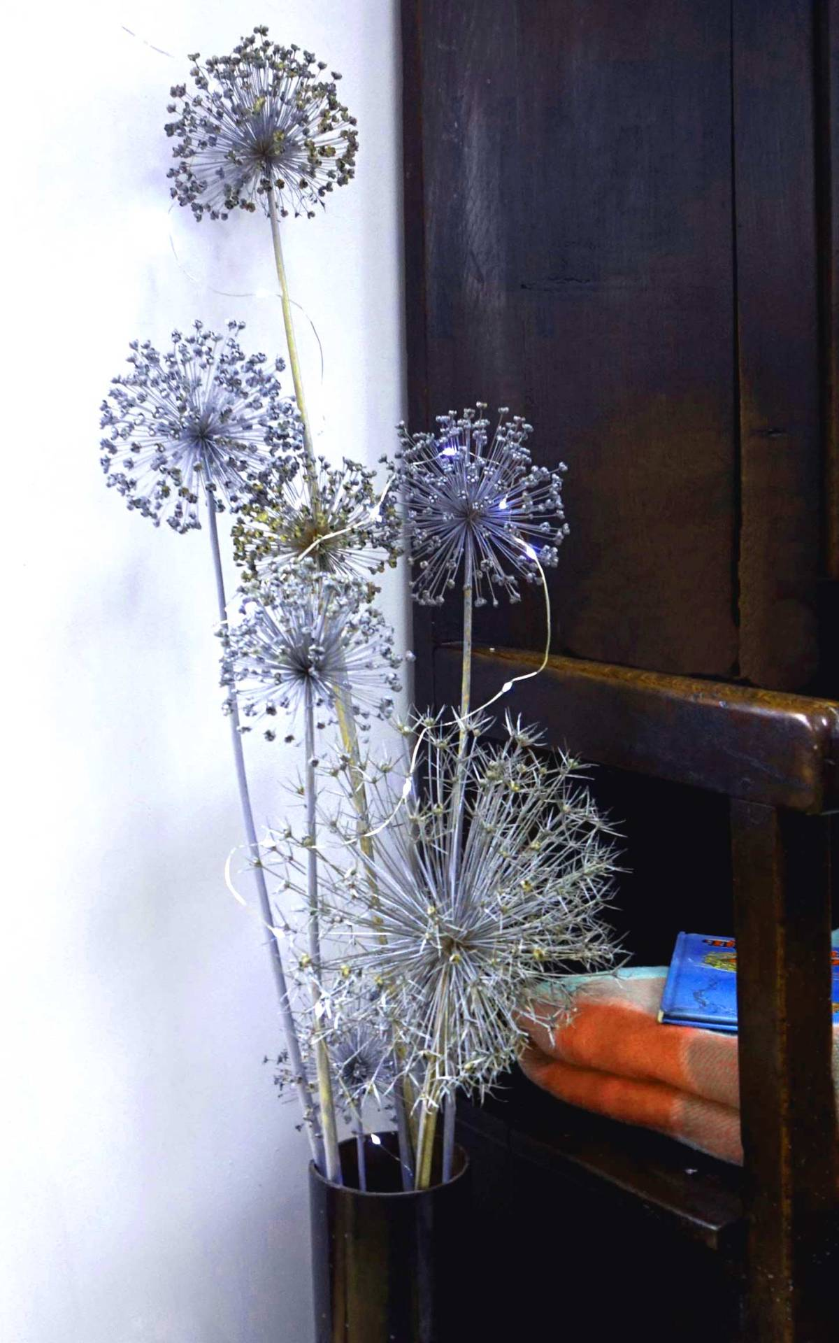 Aliums are great for a structural Christmas decoration. I used this vintage stove flue pipe to show them off in. Hung and dried when they went to seed in the autumn, I sprayed them early in December with silver and a little gold paint. Their natural shapes and formations speak of sparklers, fireworks, snowflakes.Add some tiny lights and you can't go wrong. #DecemberPlantique#PlantiqueDecember20#ChristmasDecorations#PlantswigsandfoliageforChristmasdecorations#AliumsforChristmasDecorations#SprayedanddriedAliums