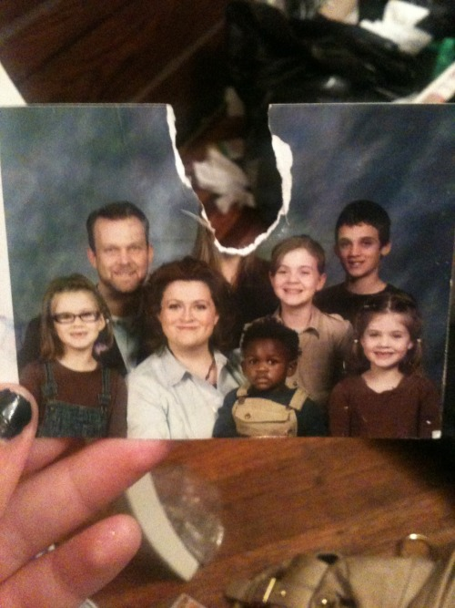 invisiblelad:  lexuswillow:  This is an old family picture. My family does not support my being in the LGBTQIA community. They actually are opposed to it. They tell me every day that its disgusting and that it's sinful and I'll go to hell for liking women.  I moved out when I was seventeen, and in January I moved back in with them because I couldn't handle everything that was going on. Every day one of my five siblings tells me to go back to Minnesota. My little brother Charlie (the black baby in the picture) is now 8 and he constantly physically attacks me and tells me that I'm not his sister and to leave. My other siblings make it very obvious and clear that they don't want me here and my parents tell me constantly that they're gonna kick me out soon.  I've been saving every penny for a bus ticket to Oregon to stay with my best friend and today I found this picture in my sisters' room ON DISPLAY. Not hidden. On display. They cut my face out of the picture. And that… That was just the last straw.  I don't care if anyone reblogs this or whatever, I don't wanna get popular, I just want people to know that this is not what a family looks like. This is not something people should have to go through. This is no life.  Heartbreaking.