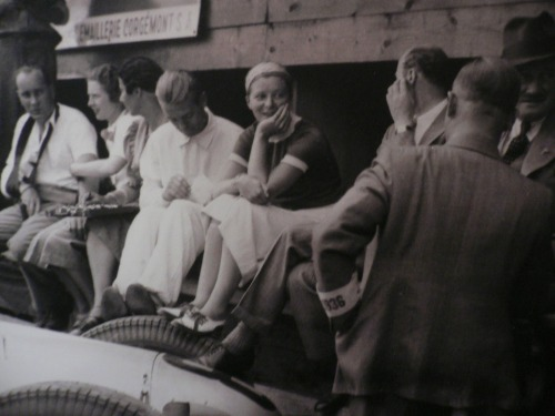 The day after the race, Bernd was asked by the Auto Union team to return to the Ring to do some filming for Auto Union, which gave Bernd an idea, according to Elly's biography:      He had long wanted to take me around the Ring in his racing car and here was his chance. 'This is a golden opportunity, Elly. You simply sit on the edge of my seat and I will drive very carefully, but fast enough that you may get an idea of what its like when I'm racing.'        I was all for it, but my enthusiasm evaporated after the very first corner! At every bend I was ready to swear an oath that we would never get round and I was almost thrown out of the Auto Union by the centrifugal force. As I clung on for dear life my husband laughed himself silly. 'What are you complaining about? I can't drive fast at all on these running-in plugs. Dawdling along like this wouldn't get us tenth place!' I was by no means ashamed of my timidity. On the contrary, I was grateful for the chance to get some idea of what Bernd got up to on a circuit and it was abundantly clear to me that driving a racing car was infinitely more difficult than flying.       According to the records, Rosemeyer put in a 12-minute lap with Elly on board; his qualifying time was 9 minutes and 46 seconds. ______ Elly's book about Rosemeyer career is one of my fav books. You should take a look on amazon, there are some in good condition and at great price!
