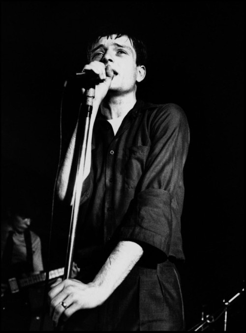 zombiesenelghetto:  Joy Division, Ian Curtis and in the back Bernard Sumner by Kevin Cummins The Factory Club, Manchester 1979