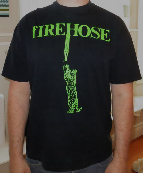 Day: 648 Shirt: fIREHOSE - Cat With Hose Color: Black Brand: Hanes Beefy-T Source: Been looking for this bad boy for many years.  I've only seen it in the Volunteer Muster Roll along with two other firehose shirts which i believe are the only other fIREHOSE shirts i never had.   For those of you that don't know what the Volunteer Muster Roll was..it was pre internet.  in 1992 if you wanted to get a hold of your fans you either had to tour or send them something in the mail.  In a nut shell this is essentially a blog post but only on paper and takes 2 weeks to arrive to you.  If you think about it this was pioneering the internet.  Mike knew how to embrace his fans.  how forward thinking of him right?