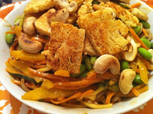 Soba noodles with julienne carrots and courgettes, edamame, yellow pepper, fried tofu and toasted cashews.