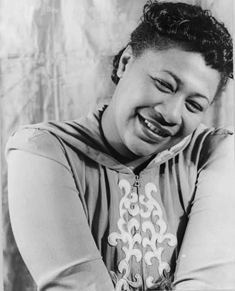 "pbsthisdayinhistory:  April 25, 1917: Ella Fitzgerald is BornOn this day in 1917, Ella Fitzgerald, the ""First Lady of Song,"" was born in Newport News, Virginia. Fitzgerald dedicated her life to jazz and she won 13 Grammy Awards and sold over 40 million albums throughout her career. Fitzgerald kicked off her jazz career after meeting musician Chick Webb and joining his band as his singer. She soon starting performing frequently at the Savoy Ballroom in Harlem. She soon became famous began as  people came from all over to see her perform alongside Chick Webb. She later gained the title as the ""Queen of Jazz"" due to signature skill in imitating instrumental sounds as she performed.Learn more about Fitzgerald's path to success with American Experience's brief overview and timeline.Image Caption: Portrait of Ella Fitzgerald by Carl Van Vechten 1940 (Library of Congress)."