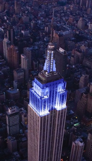 World landmarks, lit up in blue for Autism Awareness Month