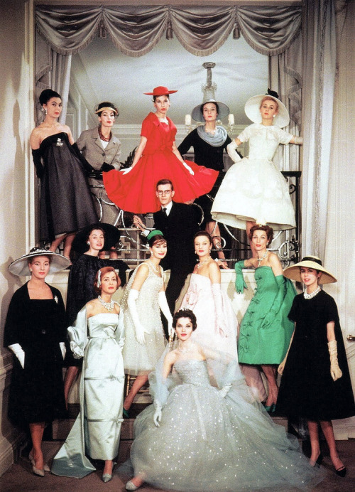 theniftyfifties:  Yves Saint Laurent surrounded by models as the new head of the House of Dior, 1958.