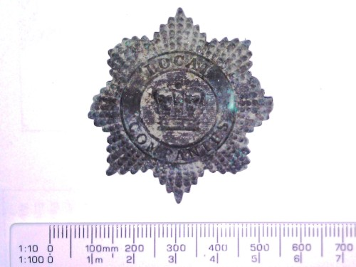 "Recently found under the floor at Gallop House. ""This gilt hat badge with the lettering 'Local Companies' was worn from 1850 to 1880 by the Enrolled Pensioner Force, military pensioners who volunteered to guard convicts on ships from England and after their arrival in Western Australia.""  (Rick Grebert, Military Badges of the Australian Colonies 1800-1903, p 278.)"