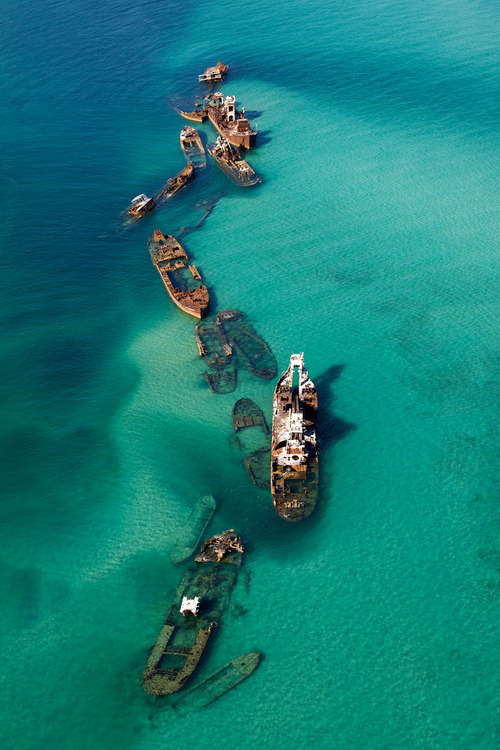 Off the Bermuda Triangle, 16+ ships washed up on a sand bar.