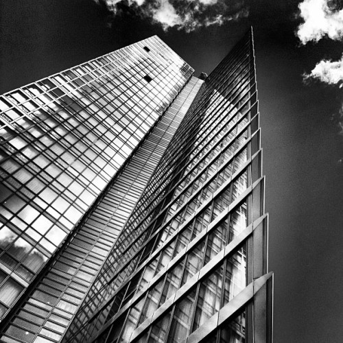 Edge mono • #1WestIndiaQuay #skyscraper #westindiaquay #londondocklands #eastlondon #london #england #greatbritain #unitedkingdom #architecture #HOK #steel #glass #side #point #edge #sky #cloud #reflection #spring #afternoon #16thMay #2013 #bw #mono #blackandwhite #inkwell #lux #st #thest  (at No.1 West India Quay)
