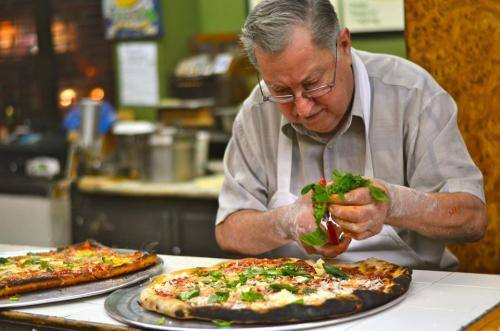 On Season 12 of America's Test Kitchen, Christopher Kimball visits Di Fara Pizza in Brooklyn and chats with chef/owner Domenico DeMarco and passionate pizza-eating regulars.