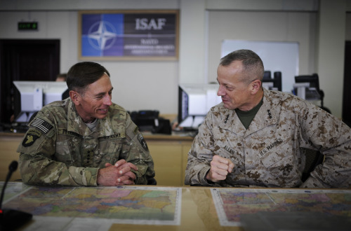 KABUL, AFGHANISTAN - JULY 13, 2011: General David Petraeus and Lt. General John Allen share a lighthearted moment in the Situational Awareness Room at the ISAF compound, just before Petraeus officially handed over command in Afghanistan to Allen (Photo by Charles Ommanney). President Obama announced today that General Allen will retire rather than seek nomination as NATO supreme allied commander.  See more images of Allen and Petraeus by Charles Ommanney here.